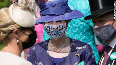 Princess Anne wore a deep blue ensemble with a bespoke face covering on the first day of Royal Ascot.
