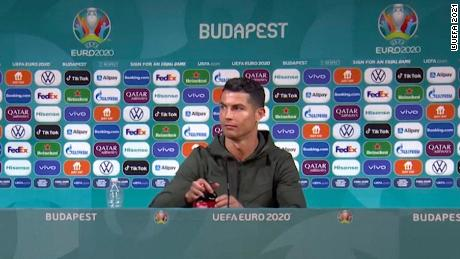 Ronaldo didn't appear to be happy with the two Coca-Cola bottles on display during his press conference.