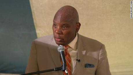 """The Rev. R. B. Holmes Jr. speaks at a tent revival hosted by his church, Bethel Missionary Baptist Church, in Tallahassee, Florida, where they're also offering vaccinations. """"Last year this time, we did not have a vaccine,"""" he said. """"I owe it to them to encourage us to make sure no one else will die."""""""