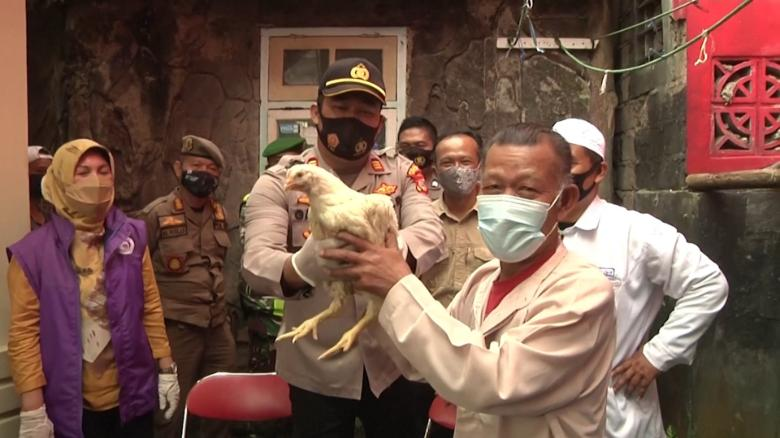 Indonesian officials give away live chickens to residents willing to get  vaccinated - CNN