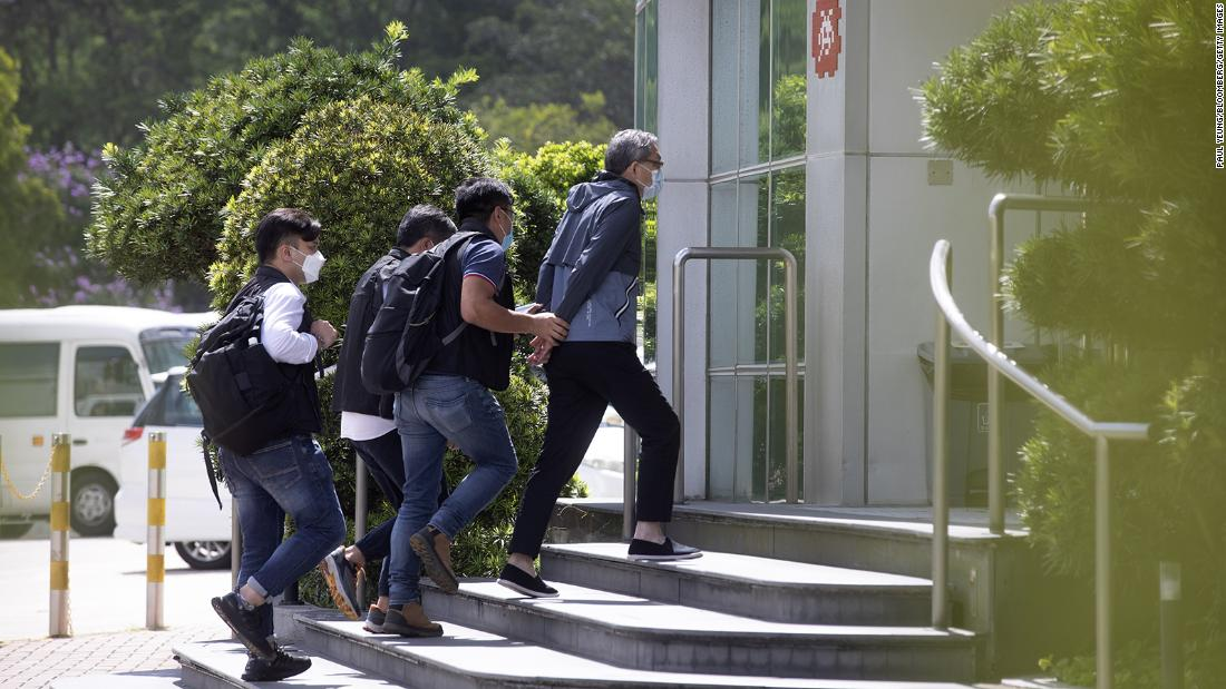 Hong Kong police declare Apple Daily newsroom a crime scene as editors and executives arrested