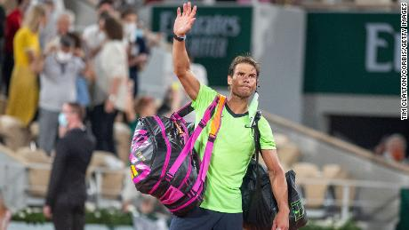 Rafael Nadal waves to the crowd after his French Open semifinal defeat to Novak Djokovic.