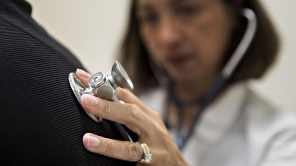 A medical doctor examines a patient with a stethoscope at a CCI Health and Wellness Services health center in Gaithersburg, Maryland, in April 2017.