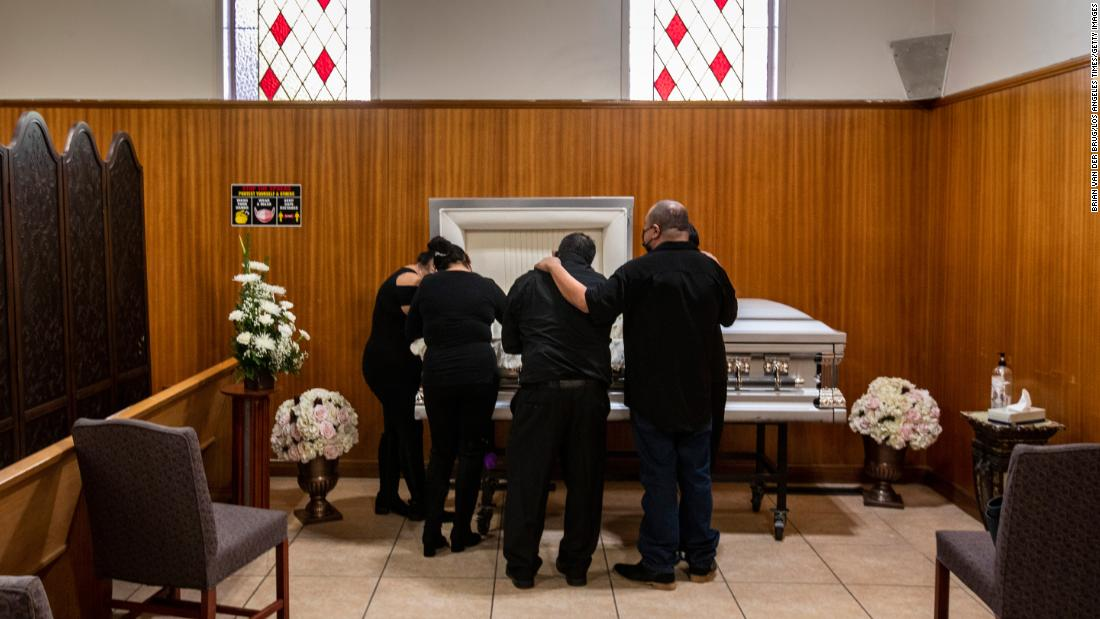 Family members gather to mourn a lost relative at the Continental Funeral Home on December 20, 2020 in East Los Angeles.