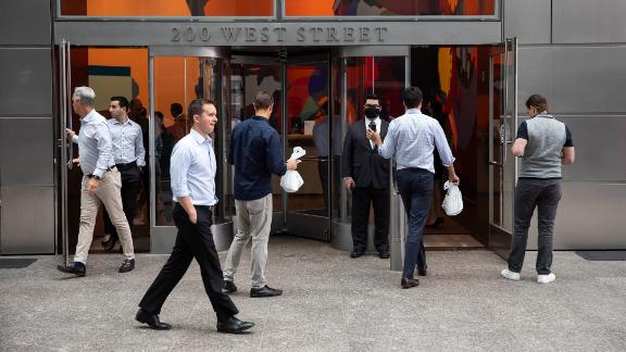 People enter the Goldman Sachs headquarters building in New York, U.S., on Monday, June 14, 2021. Goldman Sachs Group Inc. is bringing thousands of employees back to the office across the U.S. Monday for the first time in more than a year.