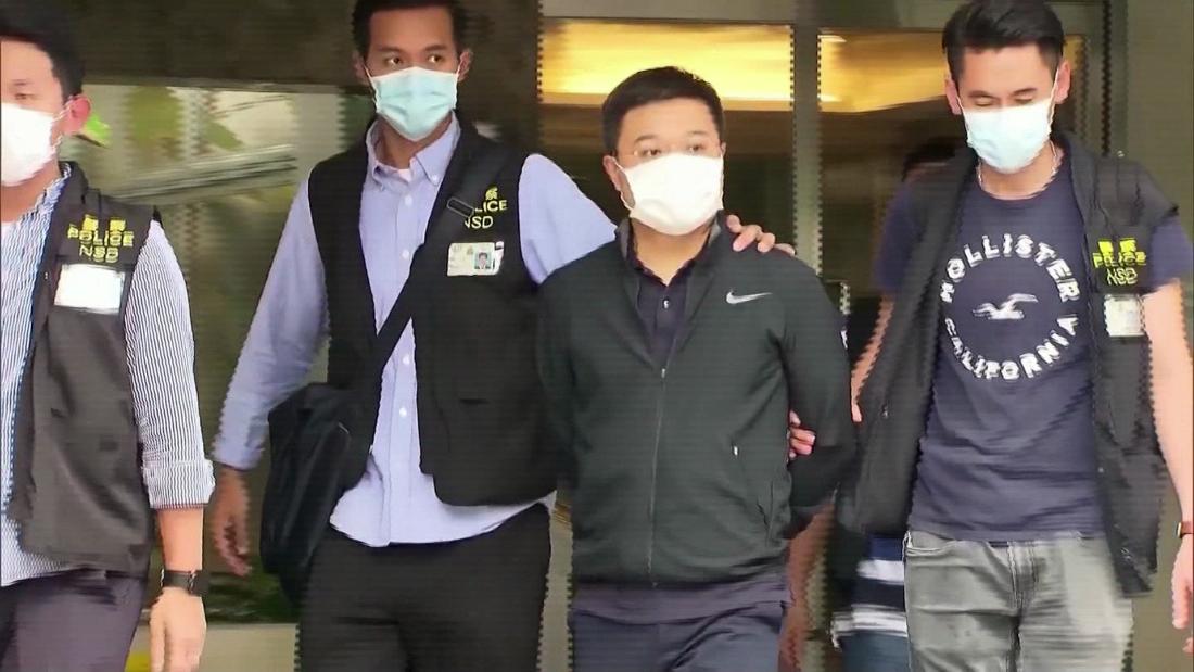 See Hong Kong police arrest Apple Daily directors - CNN Video