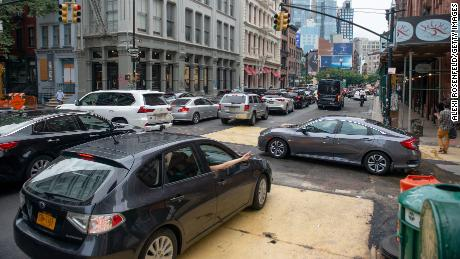 Cars crowd an intersection in the SoHo neighborhood of New York City on August 07, 2020.