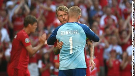 COPENHAGEN, DENMARK - JUNE 17: Simon Kjaer and Kasper Schmeichel of Denmark interact as the ball is kicked out of play in the tenth minute followed by a minute of applause in support of Denmark International Christian Eriksen, who experienced a cardiac arrest during the match against Finland during the UEFA Euro 2020 Championship Group B match between Denmark and Belgium at Parken Stadium on June 17, 2021 in Copenhagen, Denmark. (Photo by Jonathan Nackstrand - Pool/Getty Images)