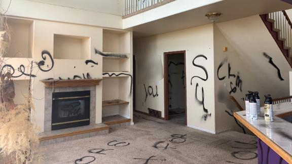 Most surfaces in this Colorado home have black spray paint. CNN has blurred portions of this image.