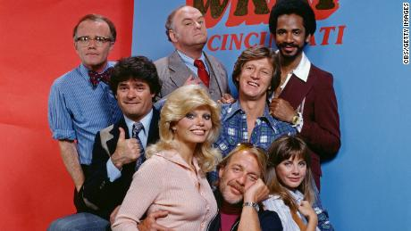 (Pictured left to right) Richard Sanders (as news director Les Nessman), Frank Bonner (as advertising salesman Herb Tarlek), Loni Anderson (as receptionist Jennifer Marlowe), Gordon Jump (as general manager Arthur 'Big Guy' Carlson),Howard Hesseman (as morning disk jockey Dr. Johnny Fever),  Gary Sandy (as radio program director Andy Travis), Jan Smithers (as assistant and traffic coordinator Bailey Quarters) and Tim Reid (as nighttime disc jockey Venus Flytrap) star on WKRP in Cincinnati, a CBS television situation comedy about characters at a radio station. Originally broadcast September 18, 1978.