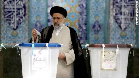 Ebrahim Raisi, a candidate in Iran's presidential elections, casts his vote at a polling station in Tehran, Iran Friday, June 18, 2021.