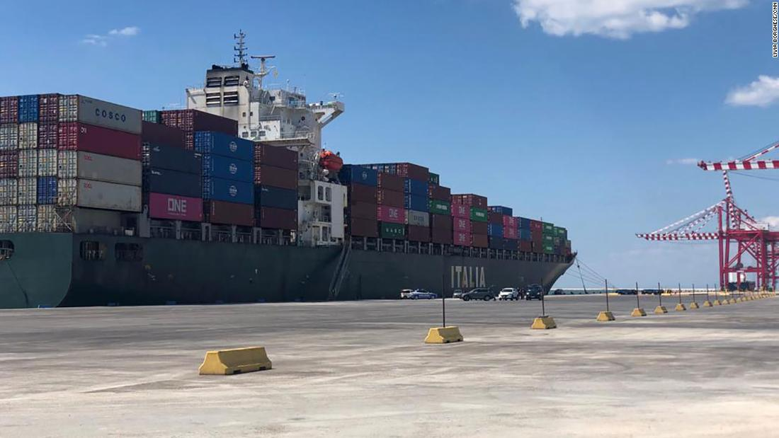 This cargo ship's captain died aboard. The crew was stuck at sea for weeks, with a potential Covid outbreak on its hands