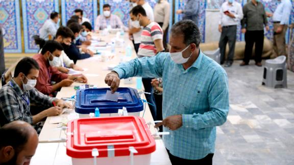 A voter casts his ballot at a polling station in Tehran on Friday.