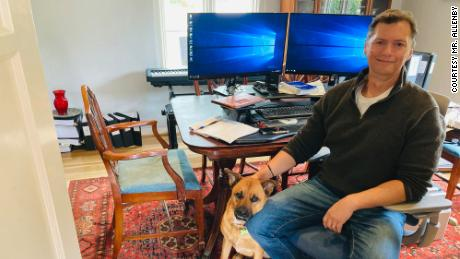 Robert Allenby in his home office with his dog Anna in San Diego, California.
