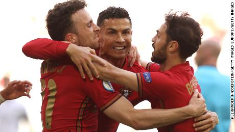 Ronaldo celebrates his goal with Jota (left) and Silva (right).