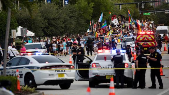 Police and firefighters respond after a truck drove into a crowd of people injuring them during The Stonewall Pride Parade and Street Festival in Wilton Manors, Fla., on Saturday, June 19, 2021.