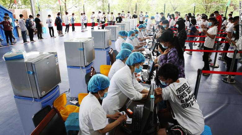 Doctors give COVID-19 vaccine to high school seniors at a temporary vaccination site in Chongqing, China on June 10.