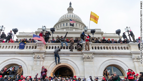Protesters seen all over Capitol building where pro-Trump supporters riot and breached the Capitol.