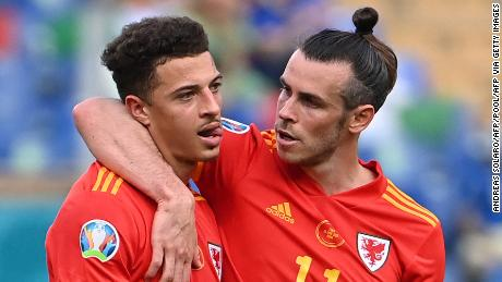 Gareth Bale, right, consoles Ethan Ampadu after his teammate's red card.