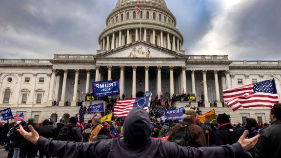 WASHINGTON, DC - JANUARY 6: Pro-Trump protesters gather in front of the U.S. Capitol Building on January 6, 2021 in Washington, DC. Trump supporters gathered in the nation's capital to protest the ratification of President-elect Joe Biden's Electoral College victory over President Trump in the 2020 election. A pro-Trump mob later stormed the Capitol, breaking windows and clashing with police officers. Five people died as a result.  (Photo by Brent Stirton/Getty Images)