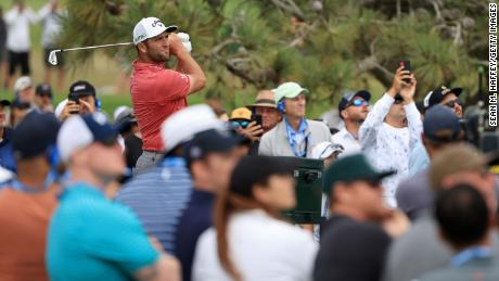 Rahm plays his shot from the 16th tee during the final round of the US Open.