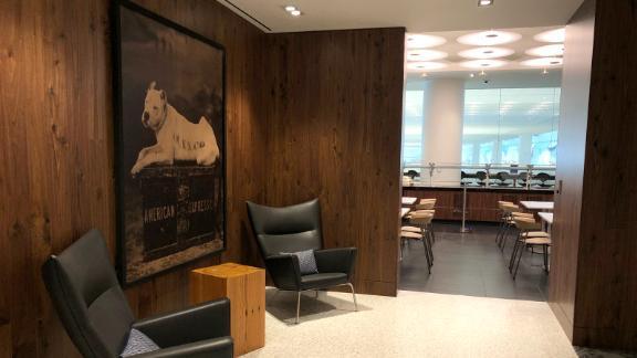 The company's original 1890 watchdog logo sits intently guarding LaGuardia's Amex Centurion Lounge.