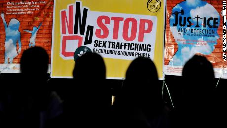 Children in front of anti-sex trafficking posters in Quezon, the Philippines, in 2010.