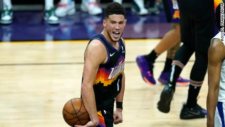 Booker celebrates in the closing seconds of the second half of Game One against the Clippers.