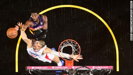 Deandre Ayton and Ivica Zubac fight for a rebound.