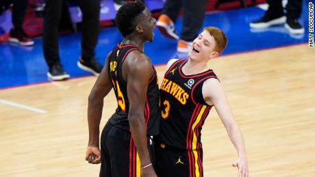 Huerter (R) and Clint Capela celebrate during the final seconds of Game Seven against the 76ers.