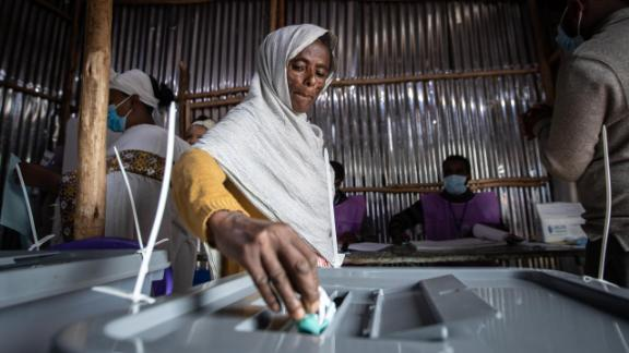 An Ethiopian woman casts her vote in the general election at a polling center near Entoto Park on the outskirts of the capital Addis Ababa, Ethiopia Monday, June 21, 2021.  Ethiopia began voting Monday in the greatest electoral test yet for Prime Minister Abiy Ahmed as war and logistical issues meant ballots wouldn't be cast in more than 100 of the 547 constituencies across the country. (AP Photo/Ben Curtis)