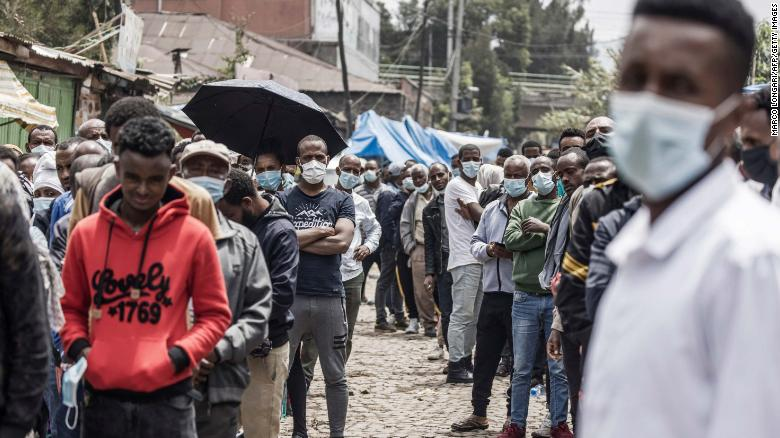 Voters queue outside a polling station in Addis Ababa on June 21.