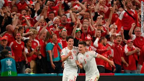Denmark's Joakim Maehle, right, celebrates after scoring his side's fourth goal against Russia.