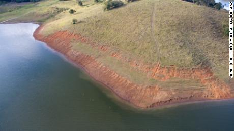 Low water levels are shown on the Jacarei River in Brazil's Sao Paulo state on June 13, 2021. A drought that has parched large parts of the country is also stoking worries about the coming fire season.