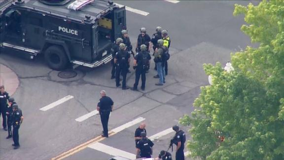 Officers respond to a shooting that left three people dead in Arvada, Colorado, on June 21, 2021.