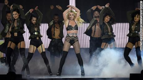 """Spears on stage during the """"Piece Of Me"""" tour in London in 2018, a decade into her conservatorship."""