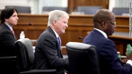 NCAA president Mark Emmert, center, speaks during a Senate  committee hearing on NCAA name, image, and likeness rights on June 9, 2021, in Washington.