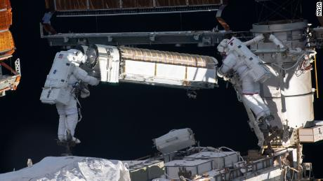 Kimbrough and Pesquet are shown working with one of the rolled up arrays.