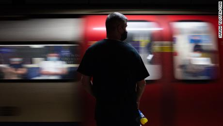 A commuter waits for a train at London Bridge Station. Laws on social distancing and mask wearing look set to be lifted later this month.