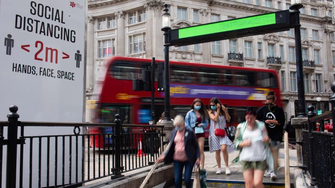 People walk into Oxford Circus Underground Station. Using public transportation again is cited as one of the activities Brits are most anxious about, according to multiple pandemic surveys.