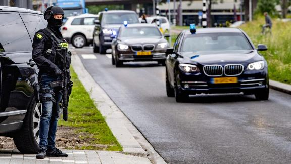 A secured transport arrives at the court in the Dutch city of Rotterdam on Tuesday ahead of Tse Chi Lop's hearing.
