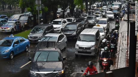 Commuters jostle for space in Jakarta's notorious traffic on April 25, 2013.