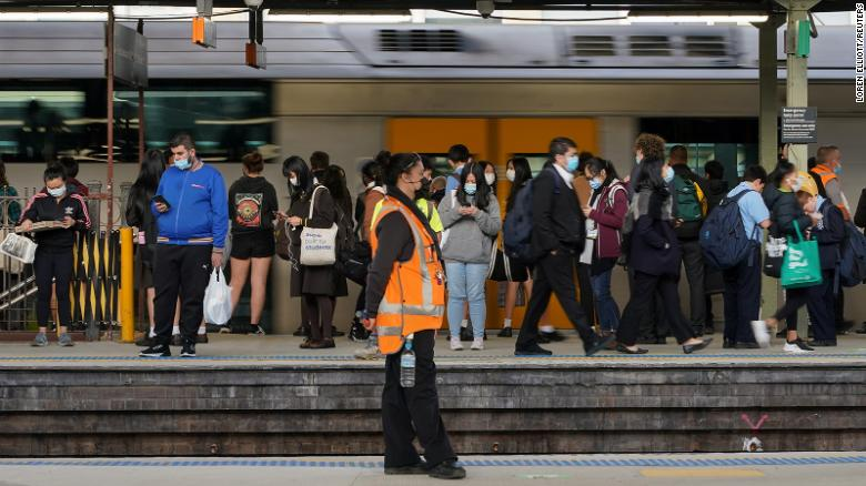Residents in parts of Sydney confined to city as Covid cases surge