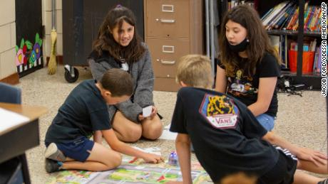 Fifth-graders program a Bee-Bot during a summer school class on June 14 at Goliad Elementary School in Odessa, Texas.