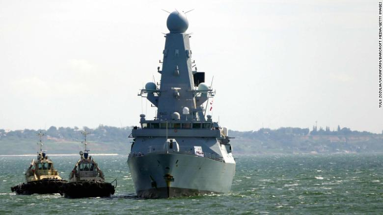 Russia says it fired warning shots on British warship but UK denies the claim