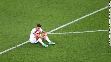 Mert Muldur looks dejected following the defeat to Switzerland.