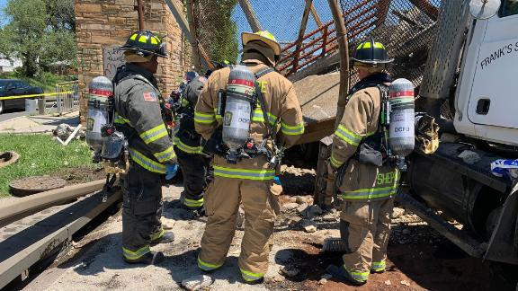 Firefighters investigate the scene on Wednesday.