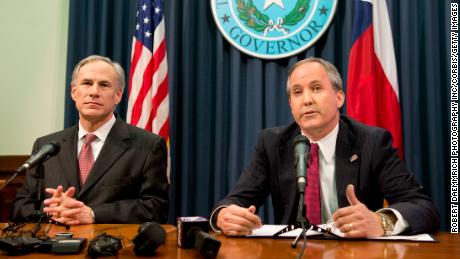 Texas Gov. Greg Abbott and Texas Attorney General Ken Paxton hold a press conference on February 18, 2015 to address a Texas federal court's decision on the immigration lawsuit filed by 26 states challenging former President Obama.
