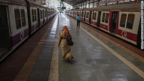 People walk along a platform at the Chhatrapati Shivaji Maharaj Terminus train station during a lockdown in Mumbai, India, on Tuesday, April 27, 2021.