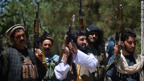 People gather with guns to support Afghanistan security forces against the Taliban, in Guzara district, Herat province on June 23.
